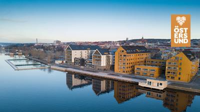 Bakgrundsbild till Teams föreställande hus på Storsjö Strand